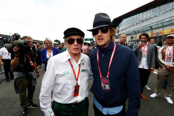 Silverstone, Northamptonshire, UK.  Sunday 16 July 2017. Sir Jackie Stewart poses with Owen Wilson. World Copyright: Glenn Dunbar/LAT Images  ref: Digital Image _X4I7287