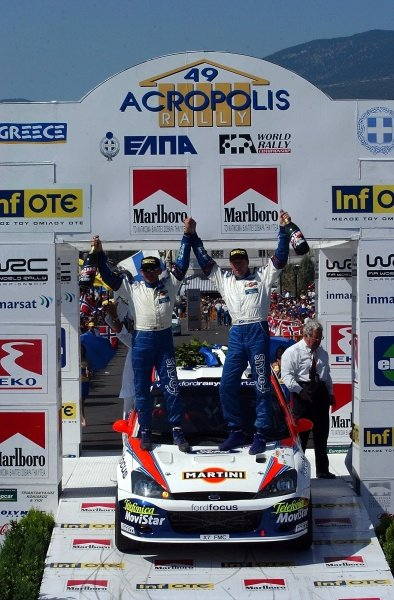 Third time consecutive Acropolis Rally winner Colin McRae (GBR), right, with co-driver Nicky Grist (GBR), left, on the podium.Acropolis Rally, Rd7, Greece. Day Three. 16 June 2002.DIGITAL IMAGE
