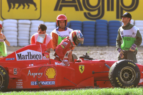 Jerez, Spain.24-26 October 1997.Michael Schumacher (Ferrari F310B) stuck in the gravel after he turned into Jacques Villeneuve at the Curva Dry Sack and decided the Drivers World Championship. Note Jacques' tyre mark on the sidepod of Michael's car.Ref-97 EUR 12.World Copyright - LAT Photographic