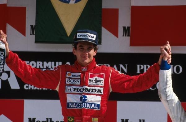 Winner Ayrton Senna (BRA) McLaren MP4/5 on the podium Mexican GP, Mexico City, 28 May 1989