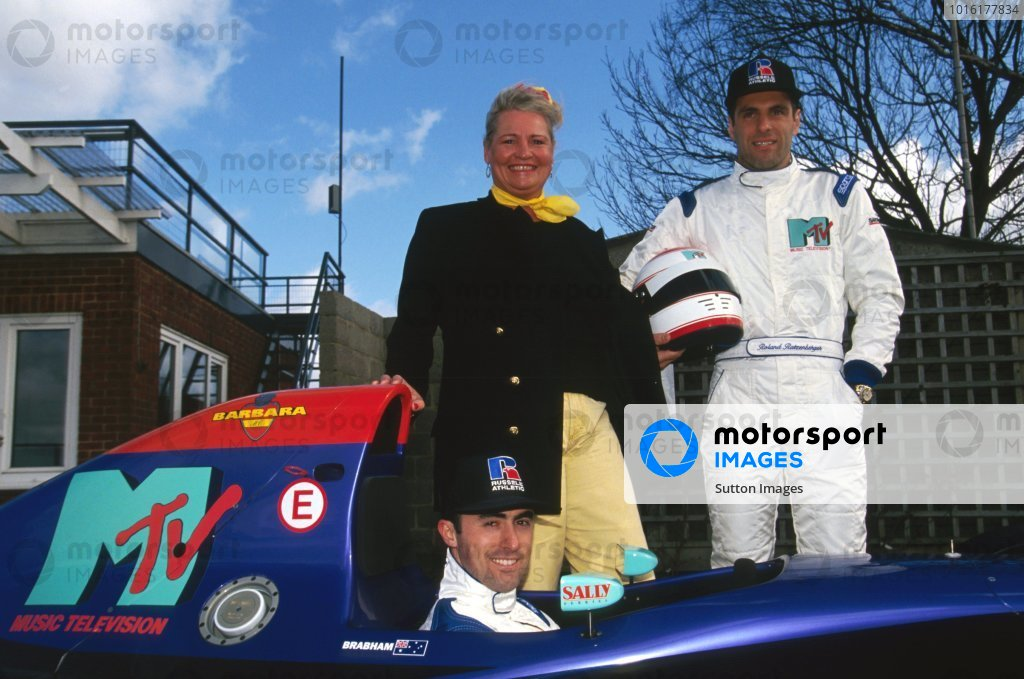 David Brabham (AUS) (in the Simtek S941) with team mate Roland Ratzenberger (AUT) (Right) stand with Barbara Behlau (AUT), a sports manager based in Monaco, who provided finance to enable Roland to sign a contract with Simtek for the first six races of the season. Formula One World Championship, Silverstone, England, 17 March 1994.