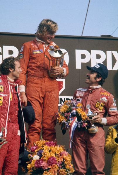 Zandvoort, Holland. 20-22 June 1975. James Hunt, Hesketh, 1st position, with Niki Lauda and Clay Regazzoni, both Ferrari, on the podium. Ref: 75HOL38. World Copyright - LAT Photographic