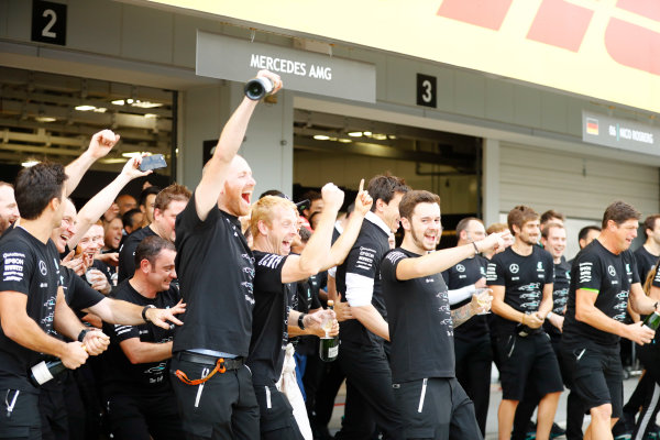 Suzuka Circuit, Japan. Sunday 09 October 2016. Members of te AMG Mercedes team celebrate their constructors' championship win. World Copyright: Steven Tee/LAT Photographic ref: Digital Image _R3I9173
