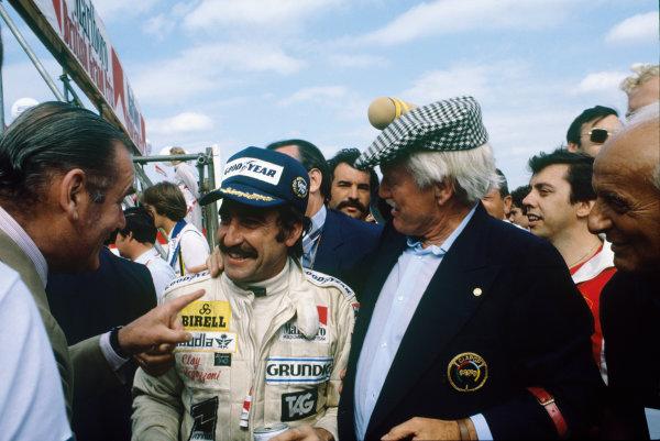 Silverstone, England. 12-14 July 1979. Clay Regazzoni (Williams FW07-Ford), 1st position, celebrates, portrait.  World Copyright: LAT Photographic. Ref:  79GB