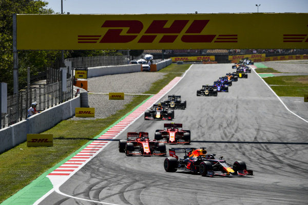 Max Verstappen, Red Bull Racing RB15, leads Sebastian Vettel, Ferrari SF90, andCharles Leclerc, Ferrari SF90, Pierre Gasly, Red Bull Racing RB15, Romain Grosjean, Haas VF-19, and Kevin Magnussen, Haas VF-19