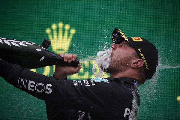 Valtteri Bottas, Mercedes, 1st position, celebrates with Champagne on the podium