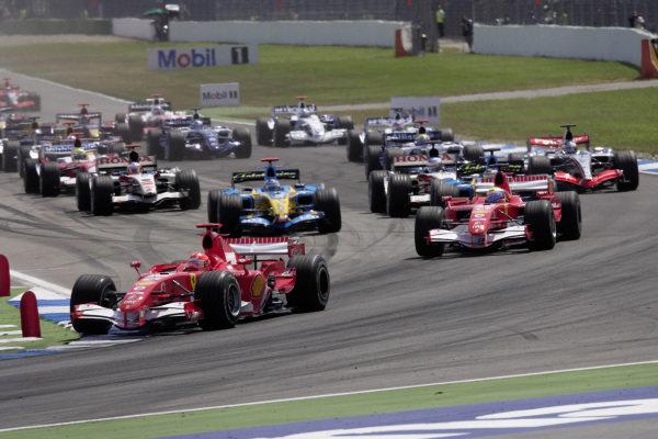 Michael Schumacher, Ferrari 248 F1 leads Felipe Massa, Ferrari 248 F1 and Giancarlo Fisichella, Renault R26 at the start.