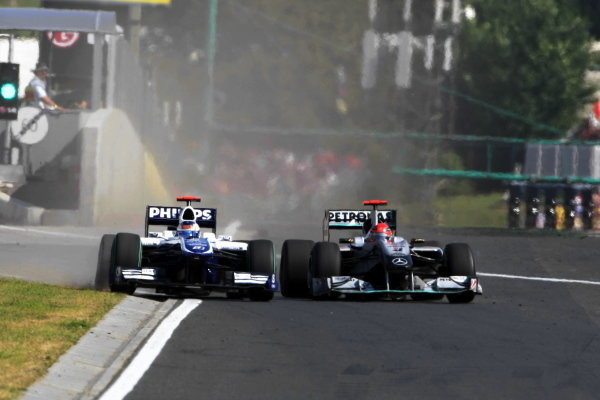 Michael Schumacher (GER) Mercedes GP MGP W01 squeezes Rubens Barrichello (BRA) Williams FW32 into the pit wall and onto the grass. Formula One World Championship, Rd 12, Hungarian Grand Prix, Race, Budapest, Hungary, Sunday 1 August 2010.  BEST IMAGE
