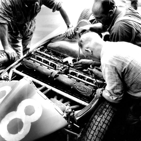 1956 French Grand Prix.Reims, France. 29/6-1/7 1956.Mechanics look at the straight 8 Bugatti 251 engine in Trintignant's Bugatti Type 251 chassis.Ref-484.World Copyright - LAT Photographic