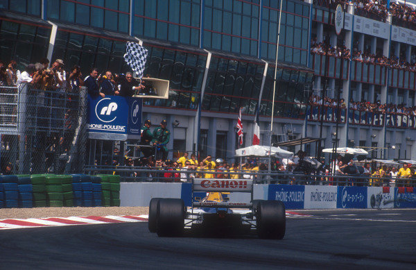 1992 French Grand Prix.Magny-Cours, France.3-5 June 1992.Nigel Mansell (Williams FW14B Renault) takes the chequered flag for 1st position.Ref-92 FRA 05.World Copyright - LAT Photographic