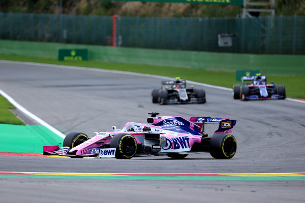 Sergio Perez, Racing Point RP19, leads Pierre Gasly, Toro Rosso STR14, and Kevin Magnussen, Haas VF-19