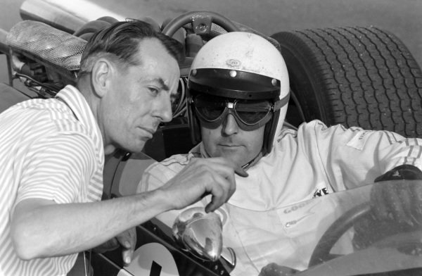 Ron Tauranac speaks with Jack Brabham as he sits in his Brabham BT24 Repco.