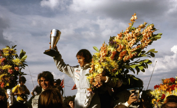The podium (L to R): Francois Cevert (FRA) Tyrrell second; Jackie Stewart (GBR) Tyrrell winner; Emerson Fittipaldi (BRA) Lotus third.  Formula One World Championship, Rd5, Belgian Grand Prix, Zolder, Belgium, 20 May 1973. BEST IMAGE