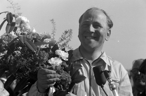 Reg Parnell receives a bouquet of flowers after finishing third.