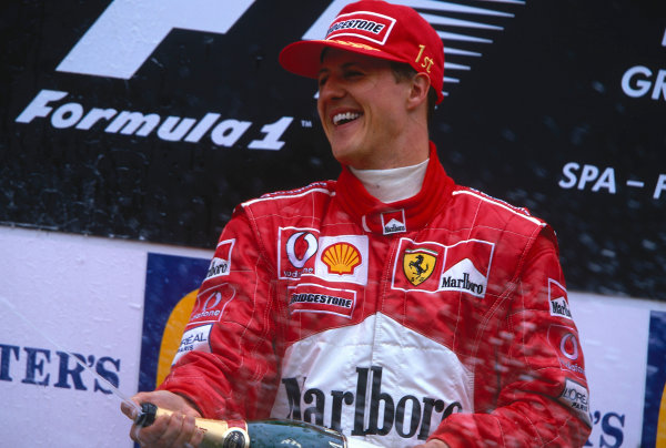 T ¨-?ian Grand Prix. Spa-Francorchamps, Belgium.  30/8-1/9 2002. Michael Schumacher (Ferrari) celebrates his 1st position and a record 10th Grand Prix win in a single season, on the podium.  Ref-02 BEL 18. World Copyright - Coates/LAT Photographic