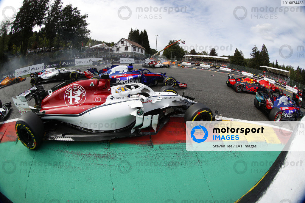Fernando Alonso, McLaren MCL33, flies over Charles Leclerc, Alfa Romeo Sauber C37, after contact with Nico Hulkenberg, Renault Sport F1 Team R.S. 18. at the start. In the foreground, Pierre Gasly, Toro Rosso STR13, leads Daniel Ricciardo, Red Bull Racing RB14, Marcus Ericsson, Alfa Romeo Sauber C37, Brendon Hartley, Toro Rosso STR13, and Lance Stroll, Williams FW41.