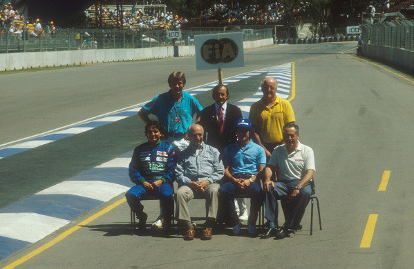 1990 Australian Grand Prix Adelaide, Australia 2-4 November 1990 A group of Formula One World Champion Drivers from past and present gathered together. Back row (L-R) James Hunt, Jackie Stewart and Denny Hulme. Front row (L-R) Nelson Piquet, Juan-Manuel Fangio, Ayrton Senna and Jack Brabham Ref-90 AUS 01 World Copyright - LAT Photographic