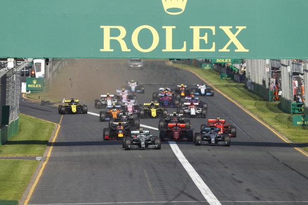 Valtteri Bottas, Mercedes AMG W10, leads Lewis Hamilton, Mercedes AMG F1 W10, Sebastian Vettel, Ferrari SF90, Charles Leclerc, Ferrari SF90, Max Verstappen, Red Bull Racing RB15, and the rest of the field at the start as Daniel Ricciardo, Renault R.S.19, damages his front wing