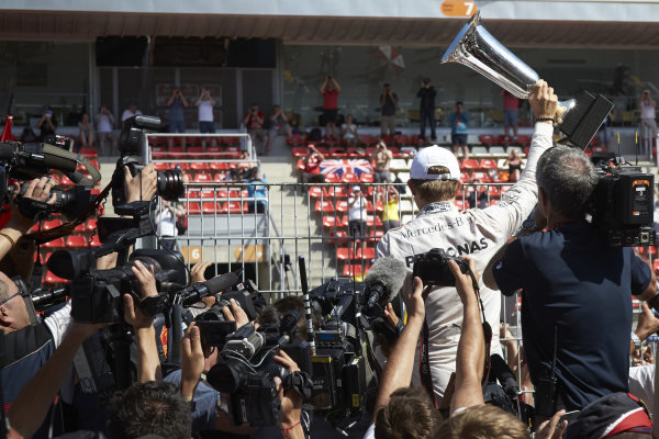 Circuit de Catalunya, Barcelona, Spain. Sunday 10 May 2015. Nico Rosberg, Mercedes AMG, 1st Position, displays his trophy to the crowd. World Copyright: Steve Etherington/LAT Photographic. ref: Digital Image SNE29822