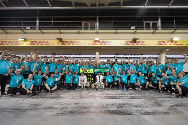 Bahrain International Circuit, Sakhir, Bahrain. Sunday 19 April 2015. Lewis Hamilton, Mercedes AMG, 1st Position, Nico Rosberg, Mercedes AMG, 3rd Position, and the Mercedes team celebrate victory. World Copyright: Steve Etherington/LAT Photographic. ref: Digital Image SNE24551