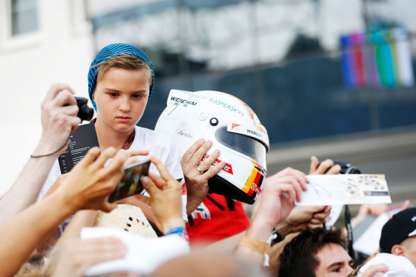 Hungaroring, Budapest, Hungary. Thursday 23 July 2015. A young fan waits to get a helmet signed by Sebastian Vettel, Ferrari. World Copyright: Charles Coates/LAT Photographic ref: Digital Image _J5R0822