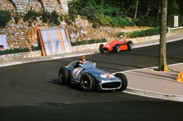 Monte Carlo, Monaco. 19-22 May 1955. Juan Manuel Fangio (Mercedes-Benz W196) leads Alberto Ascari (Lancia D50) at Station Hairpin. Ref-55 MON 06. World Copyright - LAT Photographic