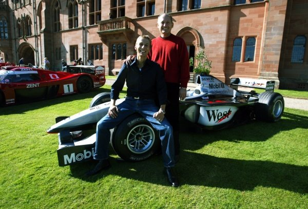 McLaren team boss Ron Dennis (GBR) stands with Johnny Dumfries, the Marquess of Bute.
