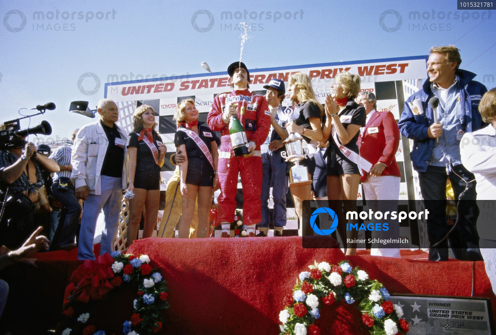 Clay Regazzoni on the podium with Patrick Depailler and Dan Gurney.
