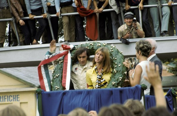 Jackie Stewart (GBR) Matra celebrates his victory and first World Championship title on the podium with his wife Helen. Italian Grand Prix, Monza, 8 September 1969. BEST IMAGE