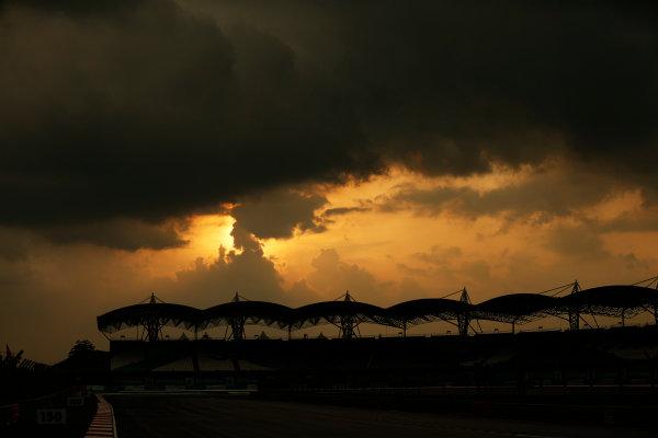 Sepang International Circuit, Sepang, Kuala Lumpur, Malaysia. Thursday 26 March 2015. Sunset over the grandstand. World Copyright: Alastair Staley/LAT Photographic. ref: Digital Image _79P1008