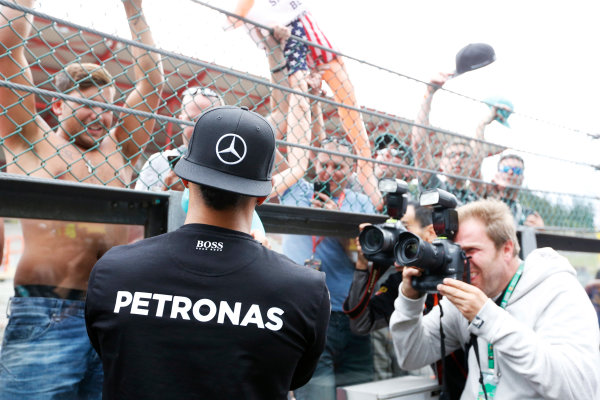 Spa-Francorchamps, Spa, Belgium. Sunday 23 August 2015. Lewis Hamilton, Mercedes AMG, signs autographs for fans. World Copyright: Alastair Staley/LAT Photographic ref: Digital Image _R6T6779