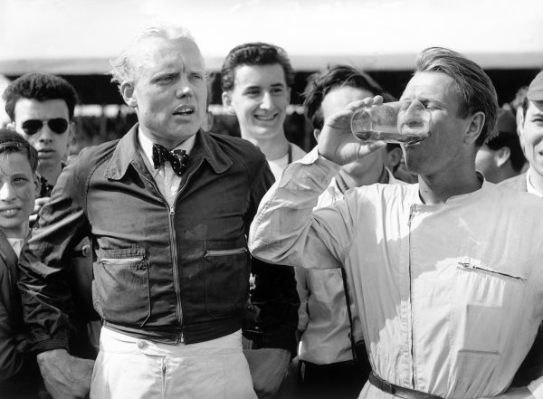 1958 British Grand Prix. Silverstone, Great Britain. 19 July 1958. Peter Collins, Ferrari Dino 246, 1st position, and Mike Hawthorn, Ferrari Dino 246, 2nd position, after the race, portrait. World Copyright: LAT Photographic Ref: C52972