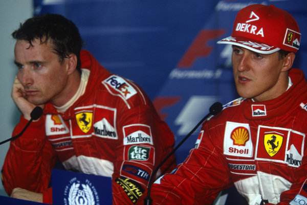 Sepang, Kuala Lumpur, Malaysia. 15-17 October 1999. Ferrari teammates Michael Schumacher and Eddie Irvine in a press conference after qualifying 1st and 2nd. Portrait. Ref: 99MAL06. World Copyright - LAT Photographic