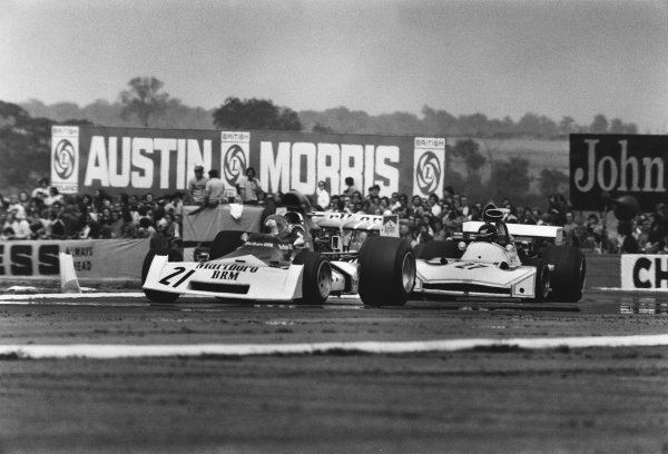 Silverstone, England. 14th July 1973. Niki Lauda (B.R.M. P160E), 12th position leads James Hunt (March 731-Ford), 4th position, action.  World Copyright: LAT Photographic.  Ref:  L73 - 1202 - 25.
