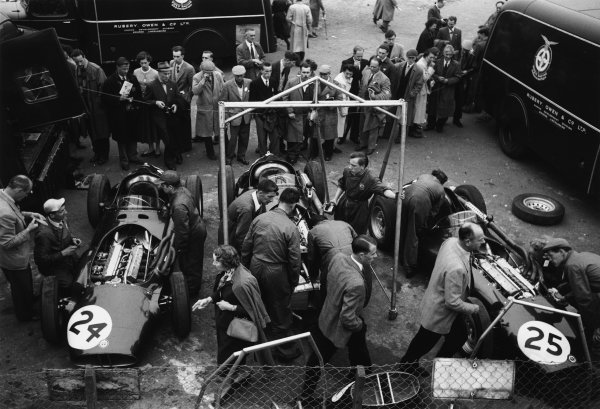 Silverstone, Great Britain. 14 July 1956.The Owen Racing Organisation mechanics work on their cars in the paddock, left-to-right: Tony Brooks, BRM P25, retired, Mike Hawthorn, BRM P25, retired, and Ron Flockhart, BRM P25, retired, atmosphere.World Copyright: LAT PhotographicRef: Autosport b&w print. Published: Autosport, 27/7/1956 p104