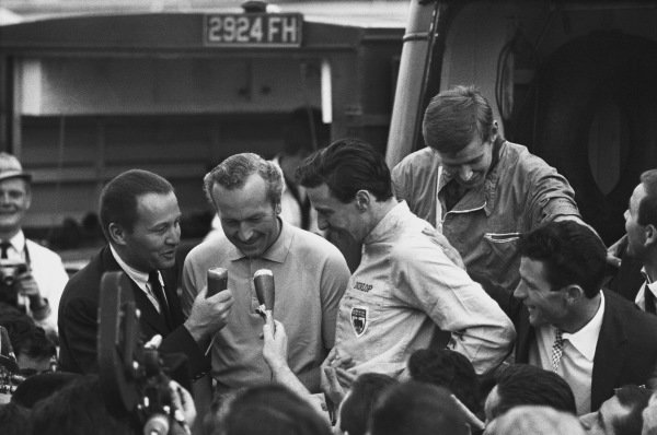 Monza, Italy. 6th - 8th September 1963.  Jim Clark (Lotus 25 Climax), 1st position with team boss Colin Chapman as they celebrate finishing in 1st position and clinching the drivers and constructors World Championship titles, portrait. World Copyright: LAT Photographic. Ref: L63 - 282 - 36.