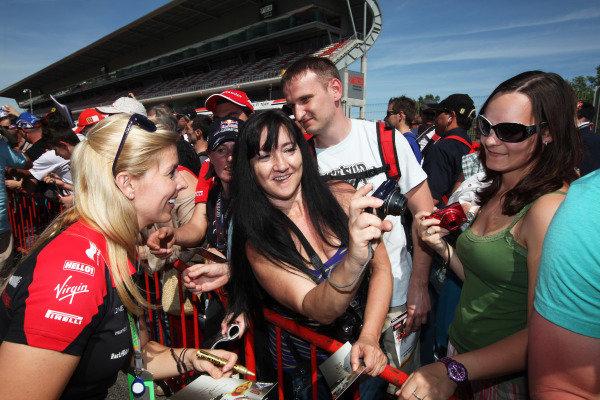 Circuit de Catalunya, Barcelona, Spain 10th May 2012 Maria de Villota, Marussia MR01 Cosworth signs autographs for fans. World Copyright:Glenn Dunbar/LAT Photographic ref: Digital Image IMG_8014