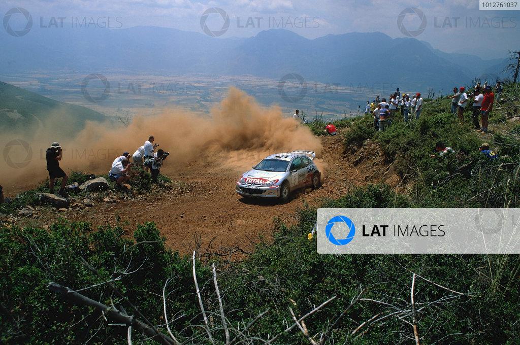 2002 World Rally ChampionshipAcropolis Rally, Greece. 13th - 16th June 2002.Richard Burns/Robert Reid, Peugeot 206 WRC, action.World Copyright: McKlein/LAT Photographicref: 35mm Image A02