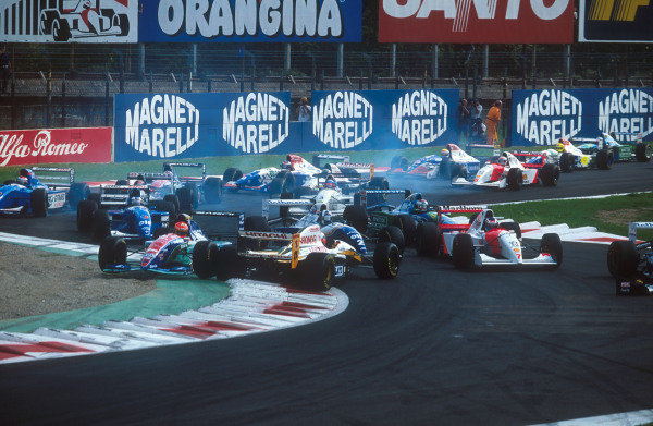 1994 Italian Grand Prix.Monza, Italy.9-11 September 1994.Johnny Herbert (Lotus 109 Mugen-Honda) is spun round at the Rettifilo Chicane at the start by Eddie Irvine (Jordan 194 Hart) because he could not brake as quickly as him so ended up hitting him from behind. Everybody else takes avoiding action in the melee.Ref-94 ITA 01.World Copyright - LAT Photographic