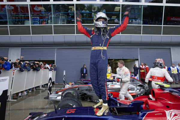 Sebastian Vettel celebrates his first pole position in parc ferme.