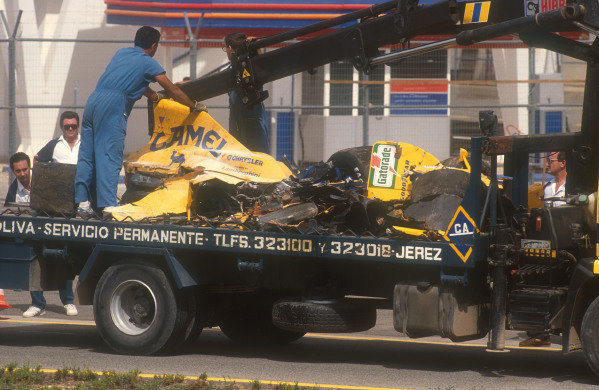 1990 Spanish Grand Prix.Jerez, Spain.28-30 September 1990.The remains of Martin Donnelly's completely destroyed Lotus 102 Lamborghini are taken back to the pits. He survived an horrific crash where he hit the barriers head on at 140mph, right at the end of Fridays qualifying session.Ref-90 ESP 01.World Copyright - LAT Photographic