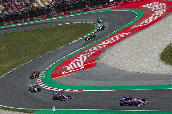 Sergio Perez, Racing Point RP19, leads Lance Stroll, Racing Point RP19,Antonio Giovinazzi, Alfa Romeo Racing C38, and Lando Norris, McLaren MCL34