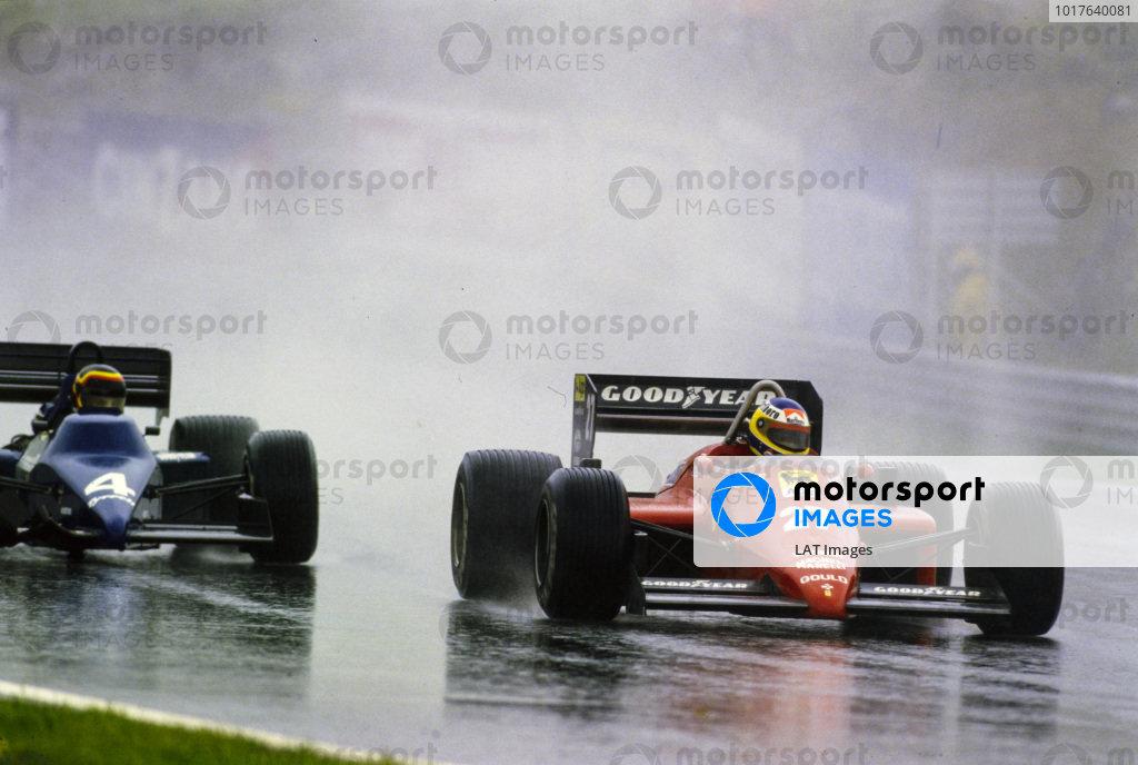 Michele Alboreto, Ferrari 156/85, battles with Stefan Bellof, Tyrrell 012 Ford. Bellof sports nose damage.