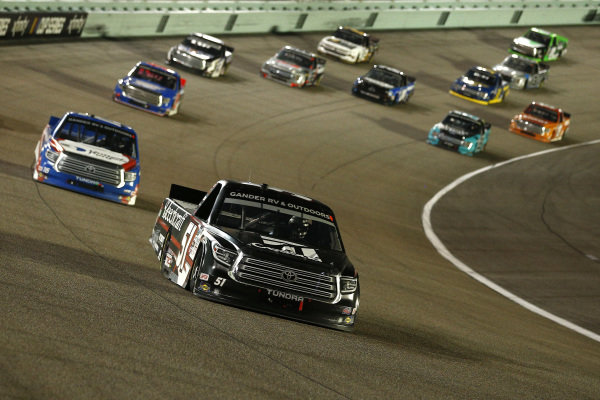 Kyle Busch, Kyle Busch Motorsports Toyota Cessna, leads a pack, Copyright: Michael Reaves/Getty Images.