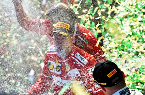 Race winner Sebastian Vettel (GER) Ferrari celebrates on the podium with the champagne at Formula One World Championship, Rd1, Australian Grand Prix, Race, Albert Park, Melbourne, Australia, Sunday 26 March 2017. BEST IMAGE