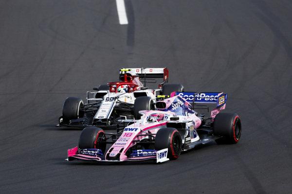 Lance Stroll, Racing Point RP19, leads Antonio Giovinazzi, Alfa Romeo Racing C38
