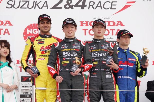 Round 2 winner Ritomo Miyata, Corolla Chukyo Kuo TOM'S Dallara F317 Toyota, celebrates on the podium with Enaam Ahmed, B-Max Racing with Motopark F3, Dallara F312 Spies A41, 2nd, and Kazuto Kotaka, Corolla Chukyo Kuo TOM'S Dallara F317 Toyota, 3rd.  Photo by Masahide Kamio