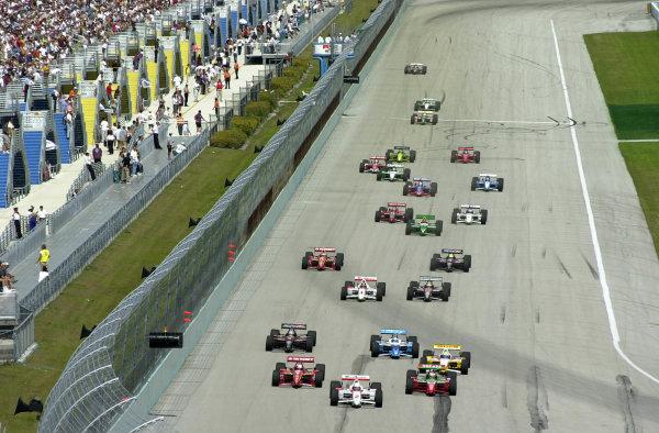 2000 CART Miami G P. Homestead-Miami SpeedwayMiami, Florida, USA, 26 March, 2000Gil de Ferran (Marlboro Team Penske Reynard-Honda) leads from the green flag-2000, Michael L. Levitt, USALAT PHOTOGRAPHIC