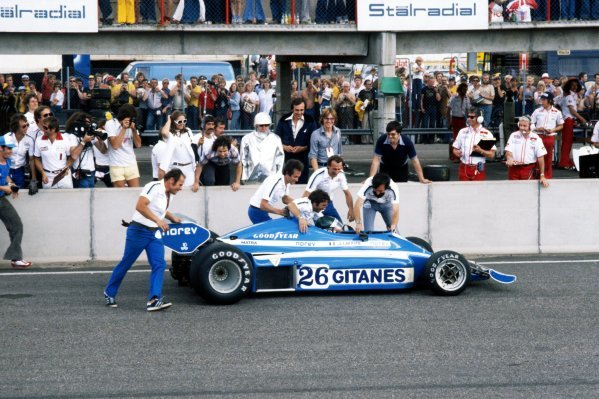 The Ligier team jump the pitwall and rush to Jacques Laffite (FRA) Ligier JS7 as he became the first all-French winner of an F1 GP.Swedish Grand Prix, Rd 8, Anderstorp, Sweden, 19 June 1977.BEST IMAGE