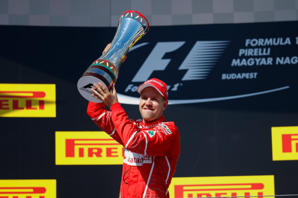 Hungaroring, Budapest, Hungary.  Sunday 30 July 2017. Sebastian Vettel, Ferrari, 1st Position, with his trophy. World Copyright: Glenn Dunbar/LAT Images  ref: Digital Image _X4I2889